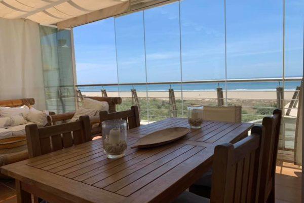 Ejemplos cortinas de cristal Playa